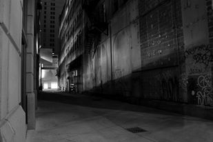 Shadowy back alley on Notorious 313 tour. Photo by Kristie Bonner