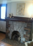 Original fireplace & plaster art remain intact
