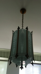 Light fixture from original construction retrofitted to  function today