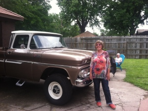 My sis Liz in front of this cool vintage truck. Behind it you'll see seating area and back yard of